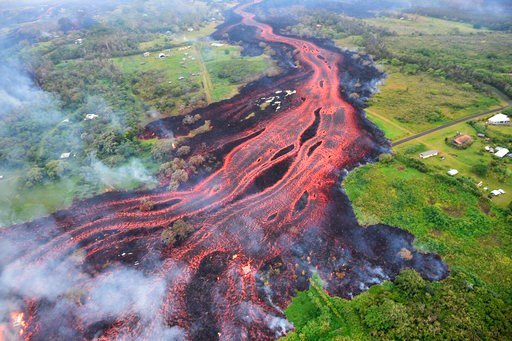 (U.S. Geological Survey via AP, File). FILE - In this May 19, 2018, file photo released by the U.S. Geological Survey, lava flows from fissures near Pahoa, Hawaii. Technically speaking, Kilauea has been continuously erupting since 1983. But the combina...