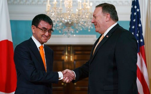 (AP Photo/Carolyn Kaster). Secretary of State Mike Pompeo shakes hands with Japanese Foreign Minister Taro Kono during a photo opportunity at the State Department in Washington, Wednesday, June 6, 2018.
