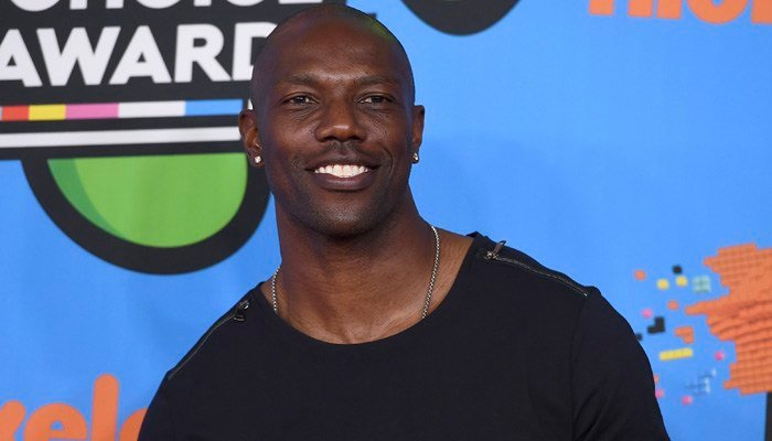 Terrell Owens says he will not attend the induction ceremony for the Pro Football Hall of Fame in August. Owens was voted into the hall in February. (Photo by Jordan Strauss/Invision/AP)