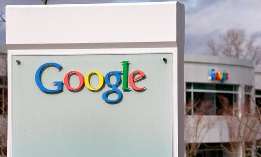 (AP Photo/Elaine Thompson, File). FILE- In this Feb. 16, 2016, file photo, signs for Google are seen on its campus during an opening for a new building in Kirkland, Wash. Google has stopped accepting political ads in Washington on the same day changes ...