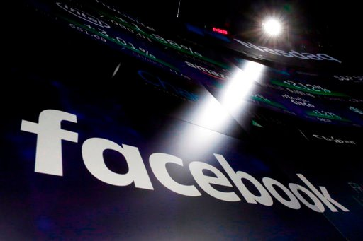 (AP Photo/Richard Drew, File). FILE- In this March 29, 2018, file photo the logo for Facebook appears on screens at the Nasdaq MarketSite in New York's Times Square. Facebook says a software bug made some private posts public for as many as 14 million ...