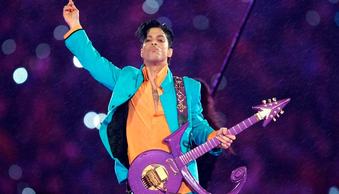 In this Feb. 4, 2007, file photo, Prince performs during the halftime show at the Super Bowl XLI football game in Miami. (Source: AP Photo/Chris O'Meara, File)