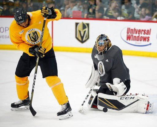 (AP Photo/John Locher). Vegas Golden Knights goaltender Marc-Andre Fleury blocks a shot tipped by right wing Ryan Reaves during an NHL hockey practice Wednesday, June 6, 2018, in Las Vegas.
