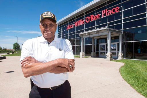 (Stephen MacGillivray/The Canadian Press via AP, File). FILE - In this June 22, 2017, file photo, Willie O'Ree, known best for being the first black player in the National Hockey League, poses for a photo at the Willie O'Ree Place in Fredericton, New B...