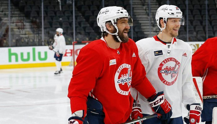 Washington Capitals' Alex Ovechkin, left, shares a laugh with Alex Chiasson, right, during an NHL hockey practice Wednesday, June 6, 2018, in Las Vegas. The Capitals lead the Vegas Golden Knights 3-1 in the best-of-seven Stanley Cup Finals series. (AP Pho