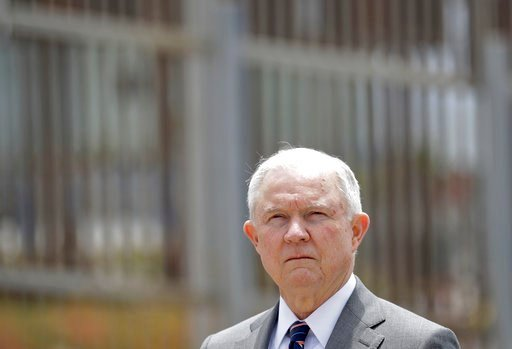 (AP Photo/Gregory Bull, File). FILE - In this May 7, 2018, file photo, Attorney General Jeff Sessions listens during a news conference in San Diego near the border with Tijuana, Mexico. A judge allowed a lawsuit challenging U.S. immigration authorities...
