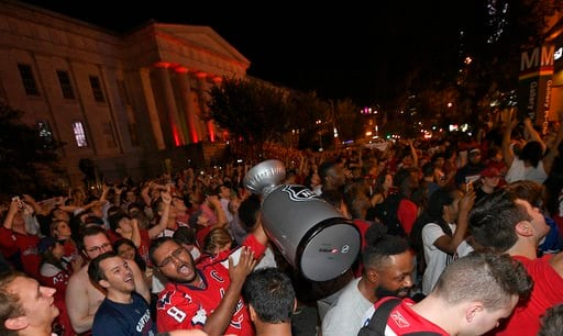 (AP Photo/Nick Wass). Washington Capitals fans celebrate in the streets outside Capital One Arena after Game 5 of the NHL hockey Stanley Cup Final between the Washington Capitals and the Vegas Golden Knights in Las Vegas, Thursday, June 7, 2018, in Was...