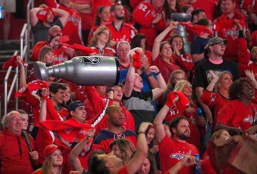 (AP Photo/Nick Wass). Fans react during a viewing party for Game 5 of the NHL hockey Stanley Cup Final between the Washington Capitals and the Vegas Golden Knights, Thursday, June 7, 2018, in Washington.