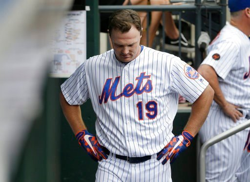 (AP Photo/Seth Wenig). New York Mets' Jay Bruce returns to the dugout after flying out during the ninth inning of a baseball game against the Baltimore Orioles at Citi Field, Wednesday, June 6, 2018, in New York. The Orioles defeated the Mets 1-0.