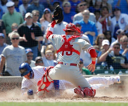 (AP Photo/Charles Rex Arbogast). Philadelphia Phillies catcher Andrew Knapp, right, blocks home plate with his left foot and tags out Chicago Cubs' Albert Almora Jr. off a sacrifice fly by Anthony Rizzo during the fifth inning of a baseball game Thursd...