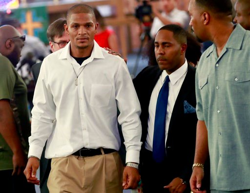 (AP Photo/Matt York). Robert Johnson, 35, left, leaves after his statement at New Beginnings Christian Church, Thursday, June 7, 2018, in Mesa, Ariz. Police in the Phoenix suburb are under fire after a video surfaced showing several officers punching J...