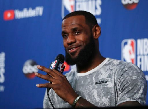 (AP Photo/Carlos Osorio). Cleveland Cavaliers forward LeBron James takes questions at a press conference after the basketball team's practiced during the NBA Finals, Thursday, June 7, 2018, in Cleveland. The Warriors lead the series 3-0 with Game 4 on ...