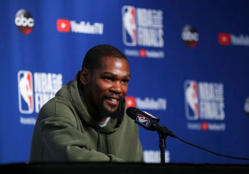(AP Photo/Carlos Osorio). Golden State Warriors forward Kevin Durant takes questions at a press conference before the basketball team's practiced during the NBA Finals, Thursday, June 7, 2018, in Cleveland. The Warriors lead the series 3-0 with Game 4 ...