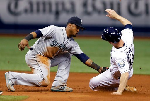 (AP Photo/Chris O'Meara). Seattle Mariners shortstop Jean Segura, left, tags out Tampa Bay Rays' Joey Wendle attempting to steal second base during the ninth inning of a baseball game Friday, June 8, 2018, in St. Petersburg, Fla.