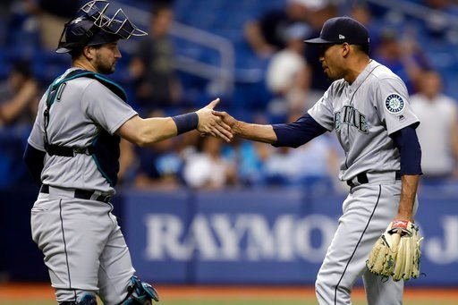 (AP Photo/Chris O'Meara). Seattle Mariners relief pitcher Edwin Diaz, right, shakes hands with catcher Mike Zunino after closing out the Tampa Bay Rays during the ninth inning of a baseball game Friday, June 8, 2018, in St. Petersburg, Fla. The Mariner...