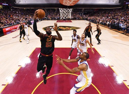 (Gregory Shamus/Pool Photo via AP). Cleveland Cavaliers' LeBron James shoots during the first half of Game 4 of basketball's NBA Finals against the Golden State Warriors, Friday, June 8, 2018, in Cleveland.