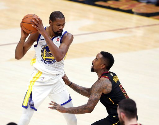 (AP Photo/Carlos Osorio). Golden State Warriors' Kevin Durant is defended by Cleveland Cavaliers' JR Smith during the second half of Game 4 of basketball's NBA Finals, Friday, June 8, 2018, in Cleveland.