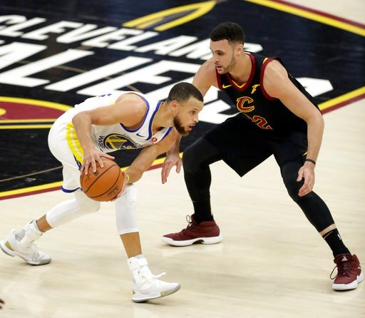 (AP Photo/Tony Dejak). Golden State Warriors' Stephen Curry is defended by Cleveland Cavaliers' Larry Nance Jr. during the first half of Game 4 of basketball's NBA Finals, Friday, June 8, 2018, in Cleveland.