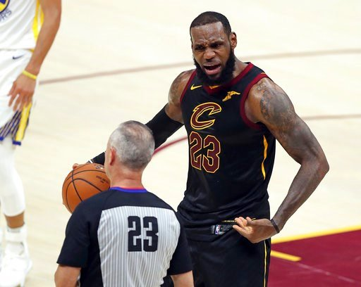 (AP Photo/Carlos Osorio). Cleveland Cavaliers' LeBron James argues a call with referee Jason Phillips during the first half of Game 4 of basketball's NBA Finals against the Golden State Warriors, Friday, June 8, 2018, in Cleveland.
