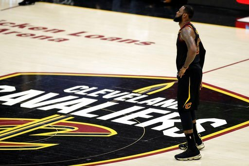 (AP Photo/Tony Dejak). Cleveland Cavaliers' LeBron James watches during the first half of Game 4 of basketball's NBA Finals against the Golden State Warriors, Friday, June 8, 2018, in Cleveland.