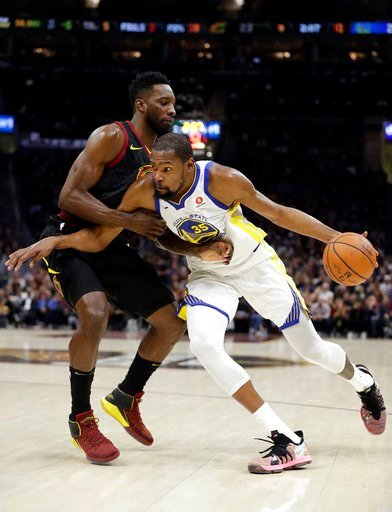 (AP Photo/Tony Dejak). Cleveland Cavaliers forward Jeff Green defends against Golden State Warriors' Kevin Durant during the first half of Game 4 of basketball's NBA Finals, Friday, June 8, 2018, in Cleveland.