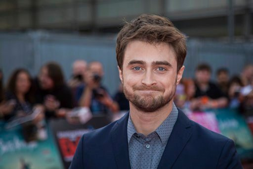 """(Photo by Vianney Le Caer/Invision/AP, File). FILE - In this Sept. 23, 2016 file photo, Daniel Radcliffe arrives at the Empire Live event in London. Radcliffe, who played the boy wizard in the J.K. Rowling franchise, will return to Broadway in """"The Lif..."""
