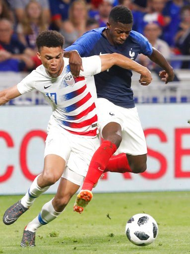 (AP Photo/Laurent Cipriani). United States' Antonee Robinson, left, battles for the ball with France's Ousmane Dembele during a friendly soccer match between France and USA at the Groupama stadium in Decines, near Lyon, central France, Saturday, June 9...