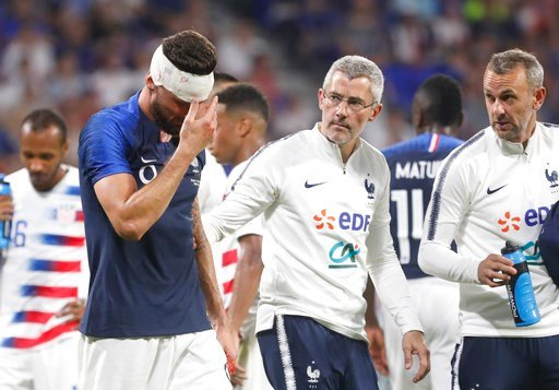 (AP Photo/Laurent Cipriani). France's Olivier Giroud injured during a friendly soccer match between France and USA at the Groupama stadium in Decines, near Lyon, central France, Saturday, June 9, 2018.
