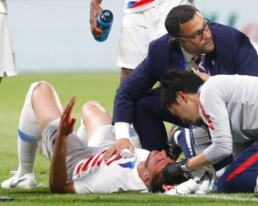 (AP Photo/Laurent Cipriani). United States' Matthew Miazga injured during a friendly soccer match between France and USA at the Groupama stadium in Decines, near Lyon, central France, Saturday, June 9, 2018.