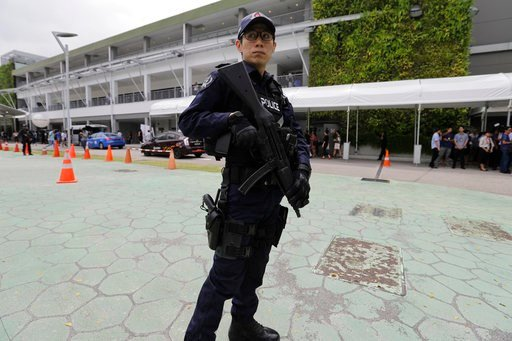 (AP Photo/Wong Maye-E). A police officer guards the entrance of the international media center Sunday, June 10, 2018, in Singapore, ahead of the summit between U.S. President Donald Trump and North Korean leader Kim Jong Un on June 12.