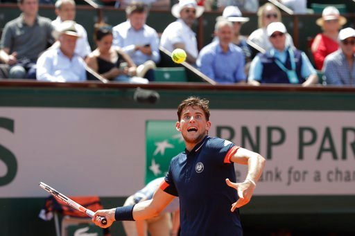 (AP Photo/Alessandra Tarantino). Austria's Dominic Thiem returns the ball to Italy's Marco Cecchinato during their semifinal match of the French Open tennis tournament at the Roland Garros stadium, Friday, June 8, 2018 in Paris.