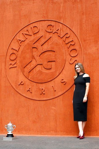 (AP Photo/Thibault Camus). Romania's Simona Halep poses with the cup at the Roland Garros stadium, Sunday, June 10, 2018 in Paris. Halep won Saturday the French Open tennis tournament women's final.