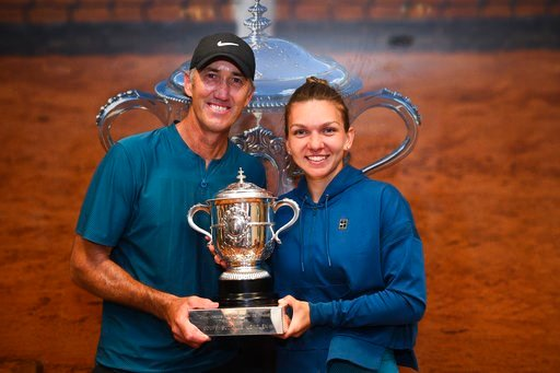 (Corinne Dubreuil / FFT via AP). In this image provided by the French Tennis Federation (FFT) Romania's Simona Halep poses with her coach Darren Cahill in the Roland Garros stadium cloakroom with her cup after defeating Sloane Stephens, of the U.S, in ...