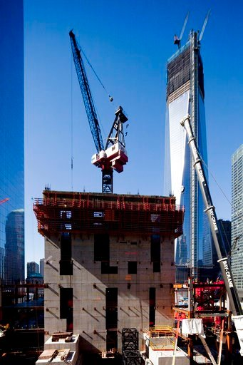 (AP Photo/Mark Lennihan, File). FILE - In this Oct. 11, 2012, file photo, a crane works on the seventh floor of 3 World Trade Center. On the right is 1 World Trade Center, and 4 World Trade Center is on the left. The new skyscraper, 3 World Trade Cente...