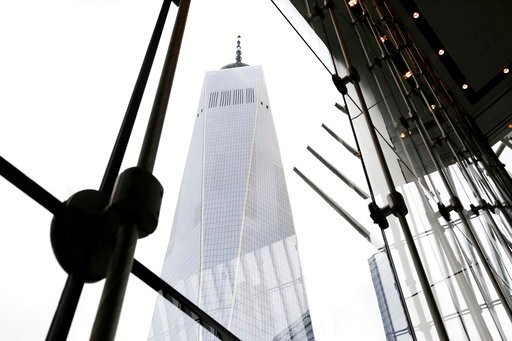 (AP Photo/Mark Lennihan). In this June 7, 2018 photo, One World Trade Center is seen from the lobby of 3 World Trade Center in New York. The center's latest skyscraper opens Monday.