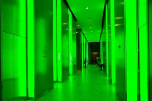 (AP Photo/Mark Lennihan). In this June 7, 2018 photo, the lobby elevator banks are bathed in green light in 3 World Trade Center in New York. The colored lighting can be used, or not, as desired by building management.