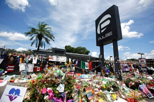 (AP Photo/John Raoux, File). FILE - In this July 11, 2016, file photo, a makeshift memorial continues to grow outside the Pulse nightclub, the day before the one month anniversary of a mass shooting, in Orlando, Fla. Survivors and victims' relatives ar...