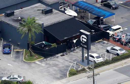 (AP Photo/Chris O'Meara, File). FILE - In this June 12, 2016, file photo, law enforcement officials work at the Pulse gay nightclub in Orlando, Fla., following a mass shooting. Survivors and victims' relatives are marking the second anniversary of the ...