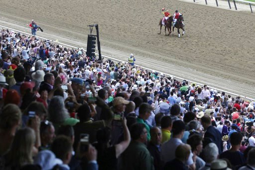 (AP Photo/Mel Evans). Justify, with jockey Mike Smith up, parades along the track after winning the Triple Crown at the 150th running of the Belmont Stakes horse race, Saturday, June 9, 2018, in Elmont, N.Y.