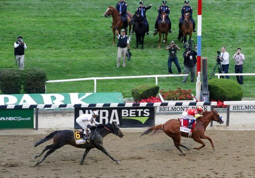 (AP Photo/Mel Evans). Justify (1), with jockey Mike Smith up, crosses the finish line to win the Triple Crown at the 150th running of the Belmont Stakes horse race, Saturday, June 9, 2018, in Elmont, N.Y.