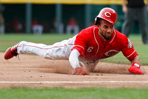 (AP Photo/John Minchillo). Cincinnati Reds' Billy Hamilton slides into third to advance on a wild pitch by starting pitcher Carlos Martinez in the fourth inning of a baseball game, Sunday, June 10, 2018, in Cincinnati.