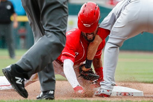 (AP Photo/John Minchillo). Cincinnati Reds' Billy Hamilton, center, beats the throw against St. Louis Cardinals first baseman Matt Carpenter, right, after advancing to third on a wild pitch by starter Carlos Martinez in the fourth inning of a baseball ...