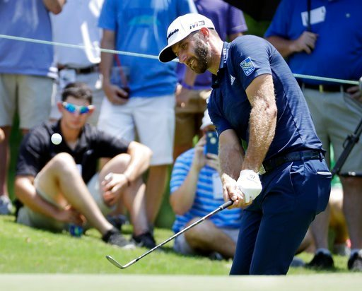 (AP Photo/Mark Humphrey). Dustin Johnson chips onto the No. 5 green during the final round of the St. Jude Classic golf tournament Sunday, June 10, 2018, in Memphis, Tenn. Johnson took a bogey on the hole.