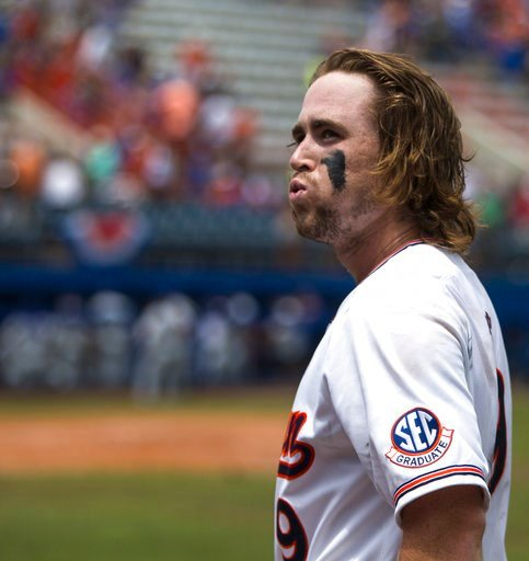 (Cyndi Chambers/The Gainesville Sun via AP). Auburn's Luke Jarvis reacts while coming off the field after hitting an RBI-single against Florida during an NCAA college super regional baseball game Sunday, June 10, 2018, in Gainesville, Fla.
