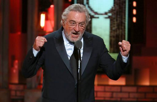 (Photo by Michael Zorn/Invision/AP). Robert De Niro introduces a performance by Bruce Springsteen at the 72nd annual Tony Awards at Radio City Music Hall on Sunday, June 10, 2018, in New York.