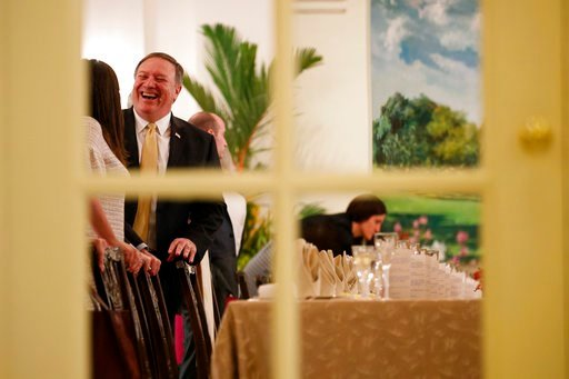 (AP Photo/Evan Vucci). Secretary of State Mike Pompeo laughs as he talks with White House press secretary Sarah Huckabee Sanders before a meeting between President Donald Trump and Singapore Prime Minister Lee Hsien Loong, Monday, June 11, 2018, in Sin...