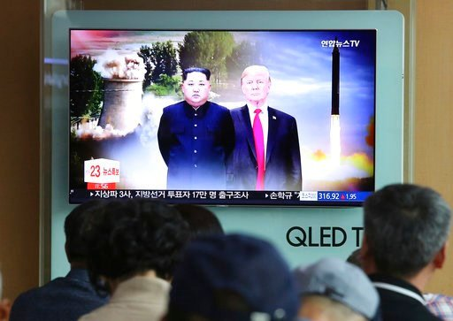 (AP Photo/Ahn Young-joon). People watch a TV screen showing file footage of U.S. President Donald Trump, right, and North Korean leader Kim Jong Un during a news program at Seoul Railway Station in Seoul, South Korea, Monday, June 11, 2018.  Final prep...
