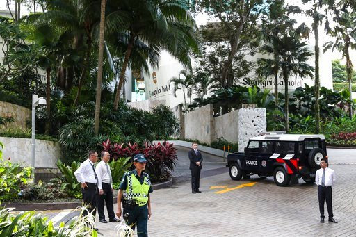 (AP Photo/Yong Teck Lim). Security personnel stand guard outside the Valley Wing of the Shangri-La Hotel in Singapore, Sunday, June 10, 2018, ahead of the summit between U.S. President Donald Trump and North Korean leader Kim Jong Un.