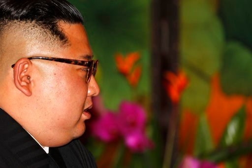 (AP Photo/Wong Maye-E). North Korean leader Kim Jong Un looks towards Singapore's Prime Minister Lee Hsien Loong during their bilateral meeting at the Istana or presidential palace on Sunday, June 10, 2018, in Singapore.