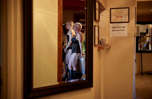 (AP Photo/John Locher). In this April 27, 2018, photo, madam Sonja Bandolik, right, and Paris Envy line up for customers at the Love Ranch brothel in Crystal, Nev. A coalition of religious groups and anti-sex trafficking activists have launched referen...